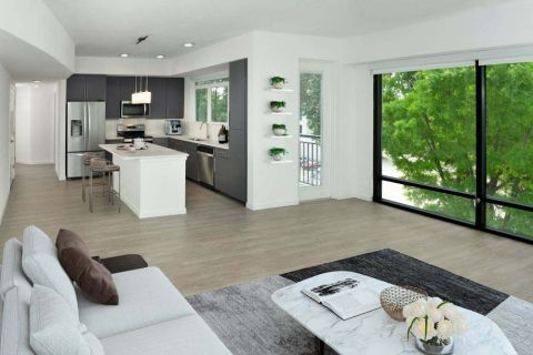Grey Kitchen and Floor to Ceiling Windows at Camden Lake Eola Apartments in Downtown Orlando, Florida
