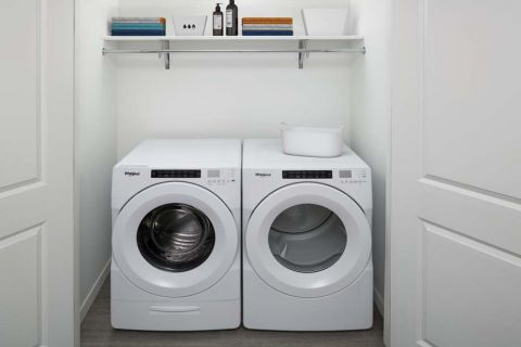 The A4 Mocha Finish Full Size Washer and Dryer at Camden Lake Eola Apartments in Downtown Orlando, Florida
