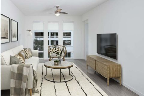 The A5 Grey Finish Living Room and Large Windows at Camden Lake Eola Apartments in Downtown Orlando, Florida