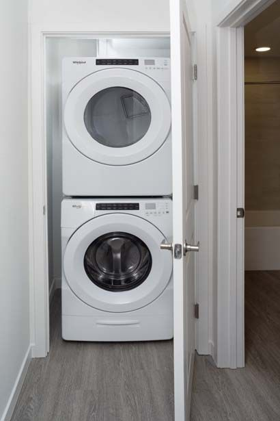 The B1 Mocha Finish Full Size Stacked Washer and Dryer The B1 Gray Finish Walk In Shower at Camden Lake Eola Apartments in Downtown Orlando, Florida