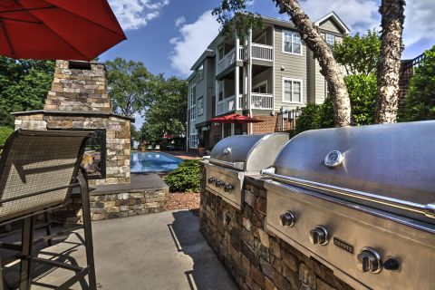 Outdoor Grills and Fireplace at Camden Lake Pine Apartments in Apex, NC