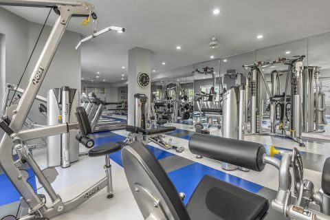 Fitness Center with Weights and Equipment at Camden Lakeway Apartments in Lakewood, CO
