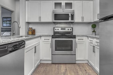 Kitchen with Stainless Steel Appliances at Camden Lakeway Apartments in Lakewood, CO