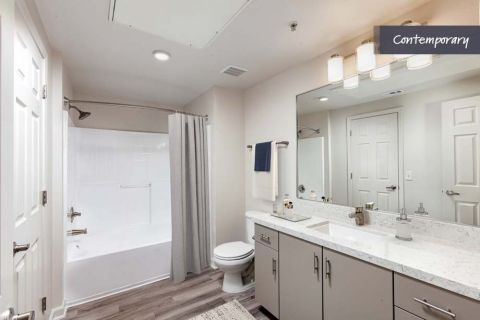 Bathroom with White Quartz Countertops and Curved Shower Rod at Camden Landmark Apartments in Ontario, CA
