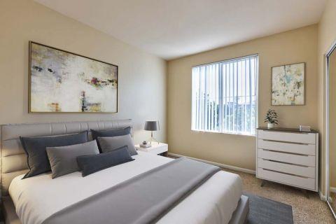 Bedroom with mirrored closet at Camden Landmark Apartments in Ontario, CA