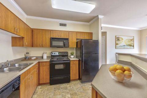Kitchen with island at Camden Landmark Apartments in Ontario, CA