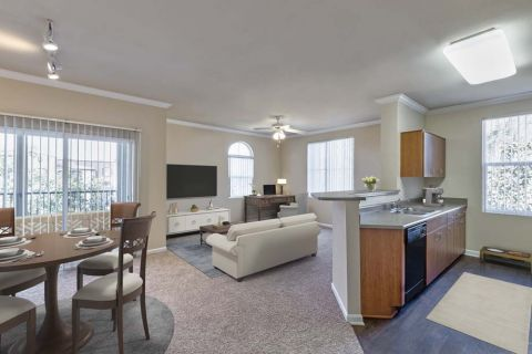 Kitchen Open Concept Living and Dining with Patio at Camden Landmark Apartments in Ontario, CA