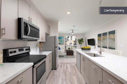 Kitchen with White Quartz Countertops and Greige Cabinets at Camden Landmark Apartments in Ontario, CA