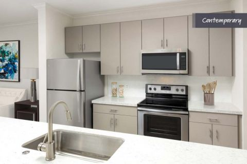 Kitchen with White Quartz Countertops and Stainless Steel Appliances at Camden Landmark Apartments in Ontario, CA