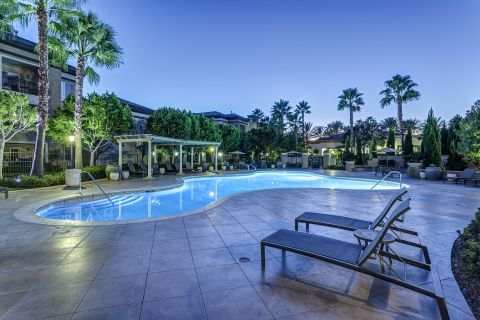 Pool at Night at Camden Landmark Apartments in Ontario, CA