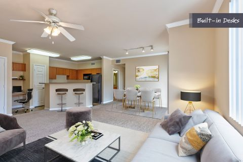 Living Room, Dining Room, and Kitchen with Built-in Desk at Camden Landmark Apartments in Ontario, CA