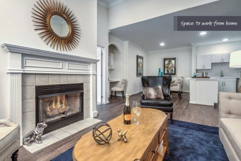 Living Room with Fireplace and Built-In Desk at Camden Lansdowne Apartments in Lansdowne, VA