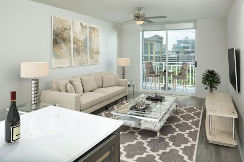 Living Room and Balcony at Camden Las Olas Apartments in Fort Lauderdale Florida