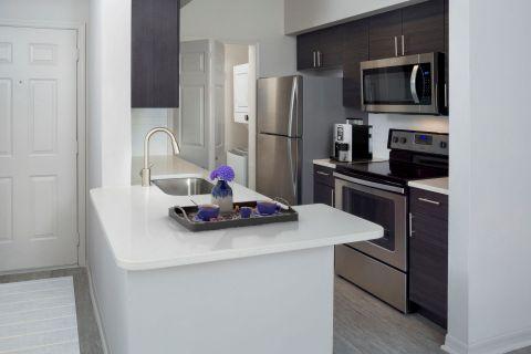 Kitchen and Washer Dryer at Camden Lee Vista Apartments in Orlando, FL