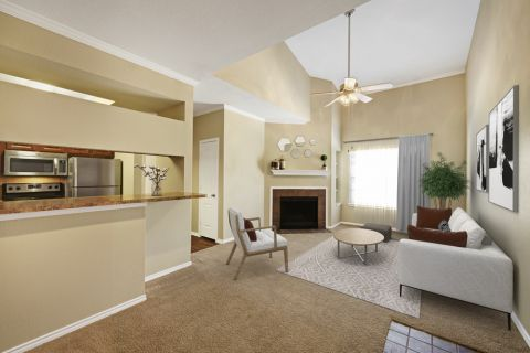 Open-Concept Living Space with Fireplace at Camden Legacy Creek Apartments in Plano, TX