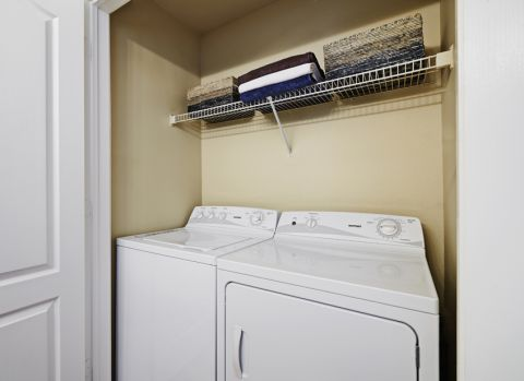 Washer and dryer at Bathroom at Camden Legacy Creek Apartments in Plano, TX