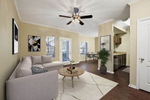 Living Dining and Kitchen in Open-Concept Floor Plan at Camden Legacy Creek Apartments in Plano, TX