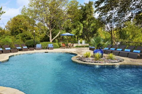 Resort-style pool at Camden Legacy Creek Apartments in Plano, TX