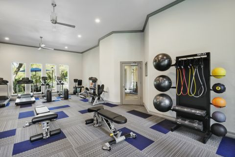 Fitness Center with free weights at Camden Legacy Creek Apartments in Plano, TX