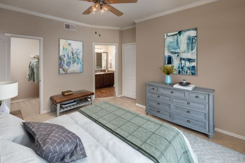 Bedroom with attached bathroom at Camden Legacy Creek Apartments in Plano, TX