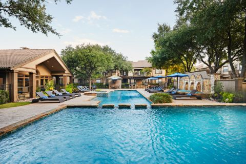 Pool behind Welcome Center at Camden Legacy Park Apartments in Plano, TX