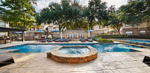 Pool with water feature at Camden Legacy Park Apartments in Plano, TX