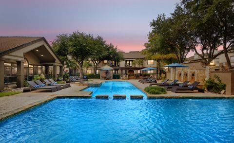 Pool at night at Camden Legacy Park Apartments in Plano, TX