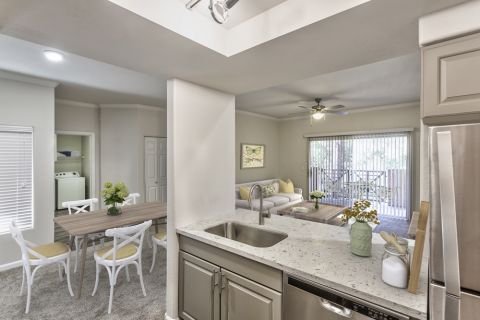 Kitchen with Stainless Steel Appliances in Two Bedroom B2 Floor Plan at Camden Legacy Apartments in Scottsdale, AZ