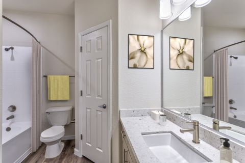 Bathroom with White Quartz Countertops in Two Bedroom B2 Floor Plan at Camden Legacy Apartments in Scottsdale, AZ