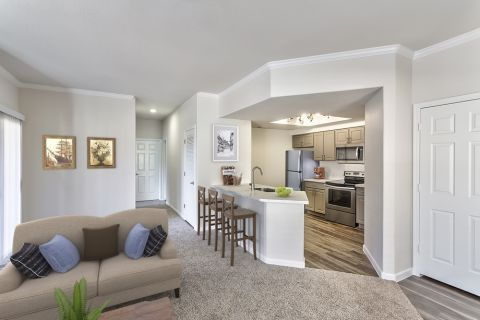 Living Room with Breakfast Bar in Two Bedroom B1 Floor Plan at Camden Legacy Apartments in Scottsdale, AZ