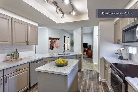 Kitchen with Large Island in Two Bedroom B4 Floor Plan at Camden Legacy Apartments in Scottsdale, AZ