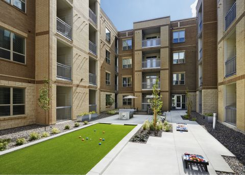 Outdoor Gaming Courtyard at Camden Lincoln Station Apartments in Lone Tree, CO