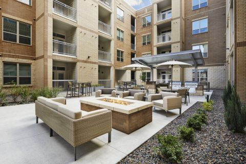 Courtyard with Outdoor Fire Pit at Camden Lincoln Station Apartments in Lone Tree, CO