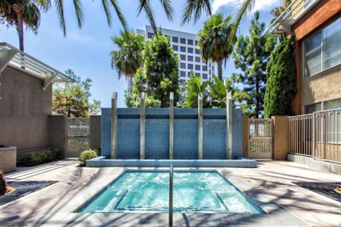 Hot Tub with Relaxing Water Feature at Camden Main and Jamboree Apartments in Irvine, CA