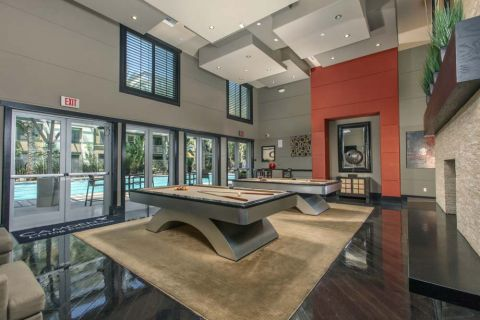 Resident Lounge with Billiards Tables at Camden Main and Jamboree Apartments in Irvine, CA