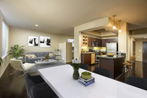 Dining Room, Living Room, and Kitchen at Camden Main and Jamboree Apartments in Irvine, CA