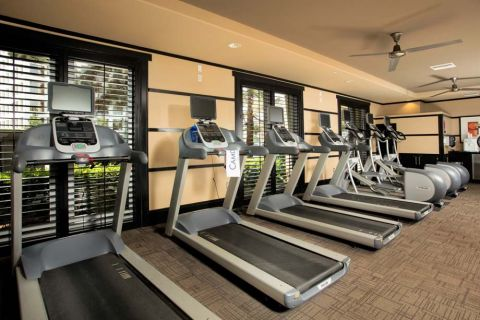 Fitness Center with Cardio Equipment at Camden Main and Jamboree Apartments in Irvine, CA