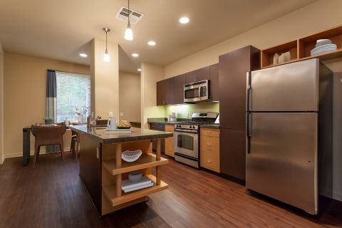 Kitchen and Dining Area at Camden Main and Jamboree Apartments in Irvine, CA