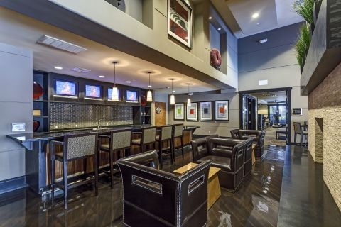 Resident Lounge with Bar at Camden Main and Jamboree Apartments in Irvine, CA