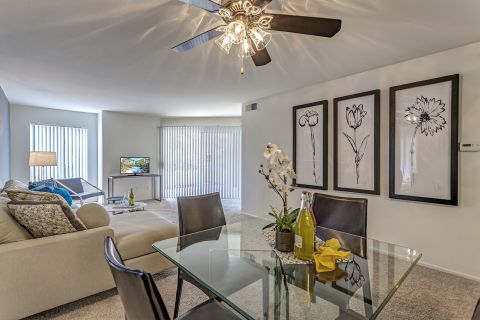 Dining Room and Spacious Living Room with Patio at Camden Martinique Apartments in Costa Mesa, CA