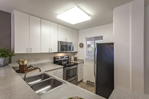 Kitchen with Bar Top at Camden Martinique Apartments in Costa Mesa, CA