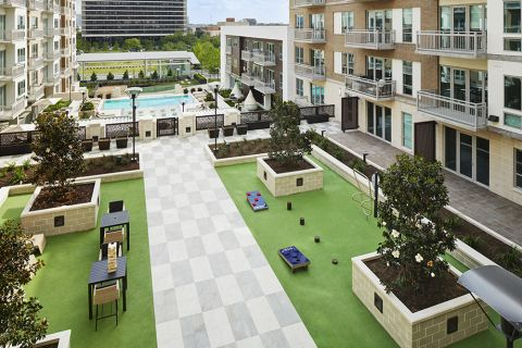Outdoor Amenity Deck with Outdoor Games at Camden McGowen Station Apartments in Houston, TX