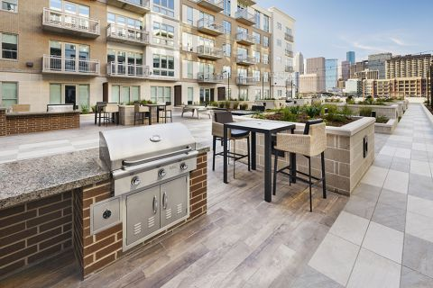 Amenity Deck with Outdoor Kitchen and BBQ Grills at Camden McGowen Station Apartments in Houston, TX