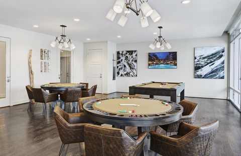 Resident Lounge with Poker Tables, Billiards and Flat Screen TV at Camden McGowen Station Apartments in Houston, TX