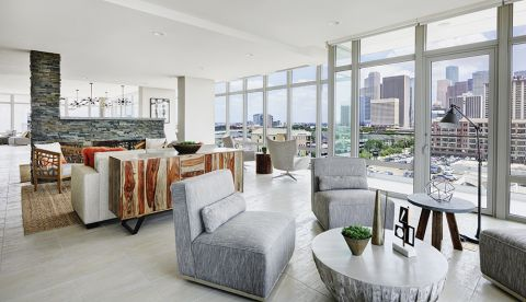 Sky Lounge with Fireplace at Camden McGowen Station Apartments in Houston, TX