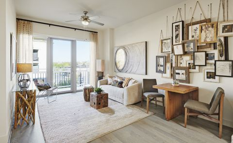 Living Room with Access to Private Balcony at Camden McGowen Station Apartments in Houston, TX