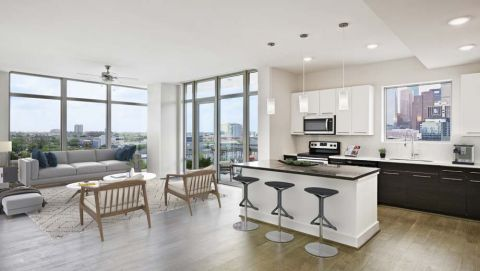 Top Floor Living Dining and Kitchen View of Downtown Houston at Camden McGowen Station Apartments in Houston, TX
