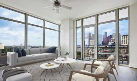 Top Floor Living Room View of Downtown Houston at Camden McGowen Station Apartments in Houston, TX