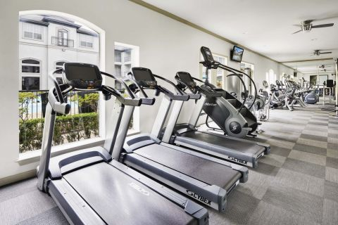 Fitness Center with Cardio Equipment at Camden Midtown Houston Apartments in Houston, TX