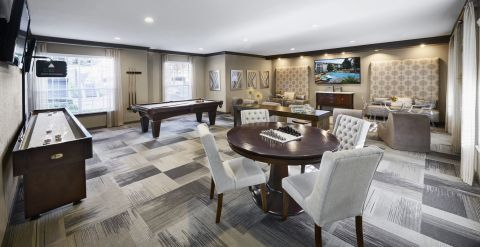 Resident Gaming Lounge with Billiards, Shuffleboard and Poker at Camden Midtown Houston Apartments in Houston, TX